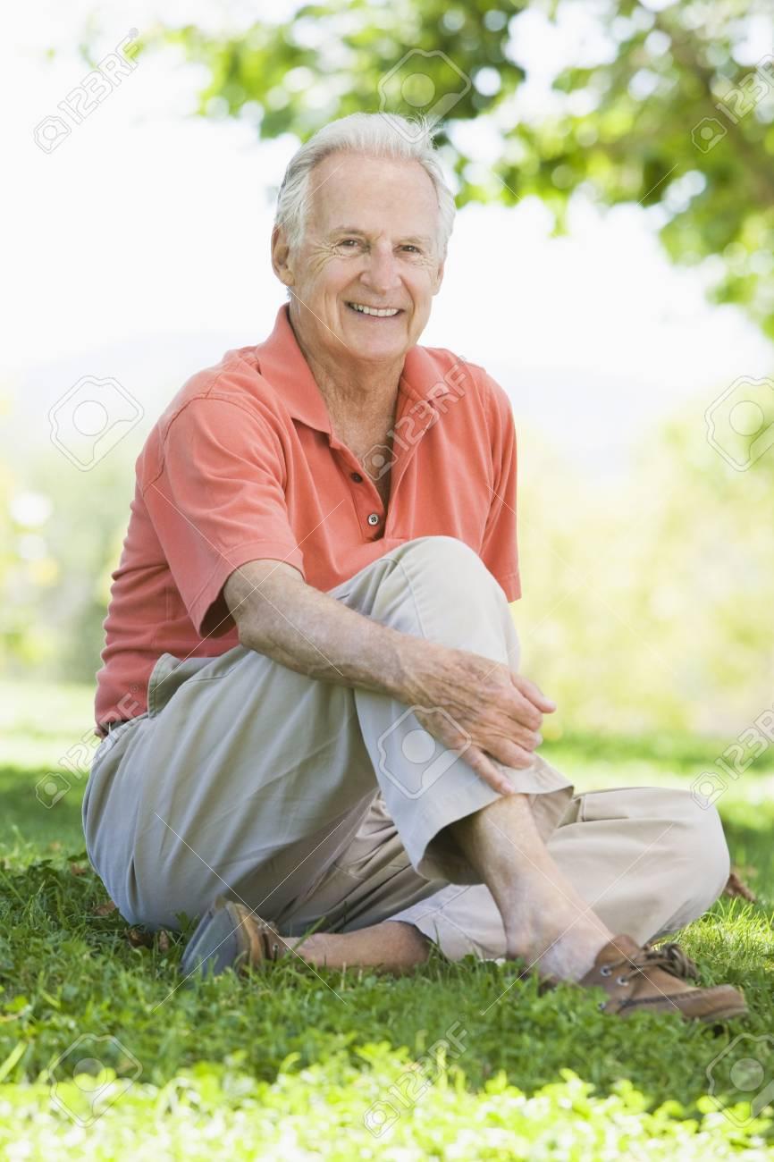 Senior man sitting outdoors Stock Photo - 3177021