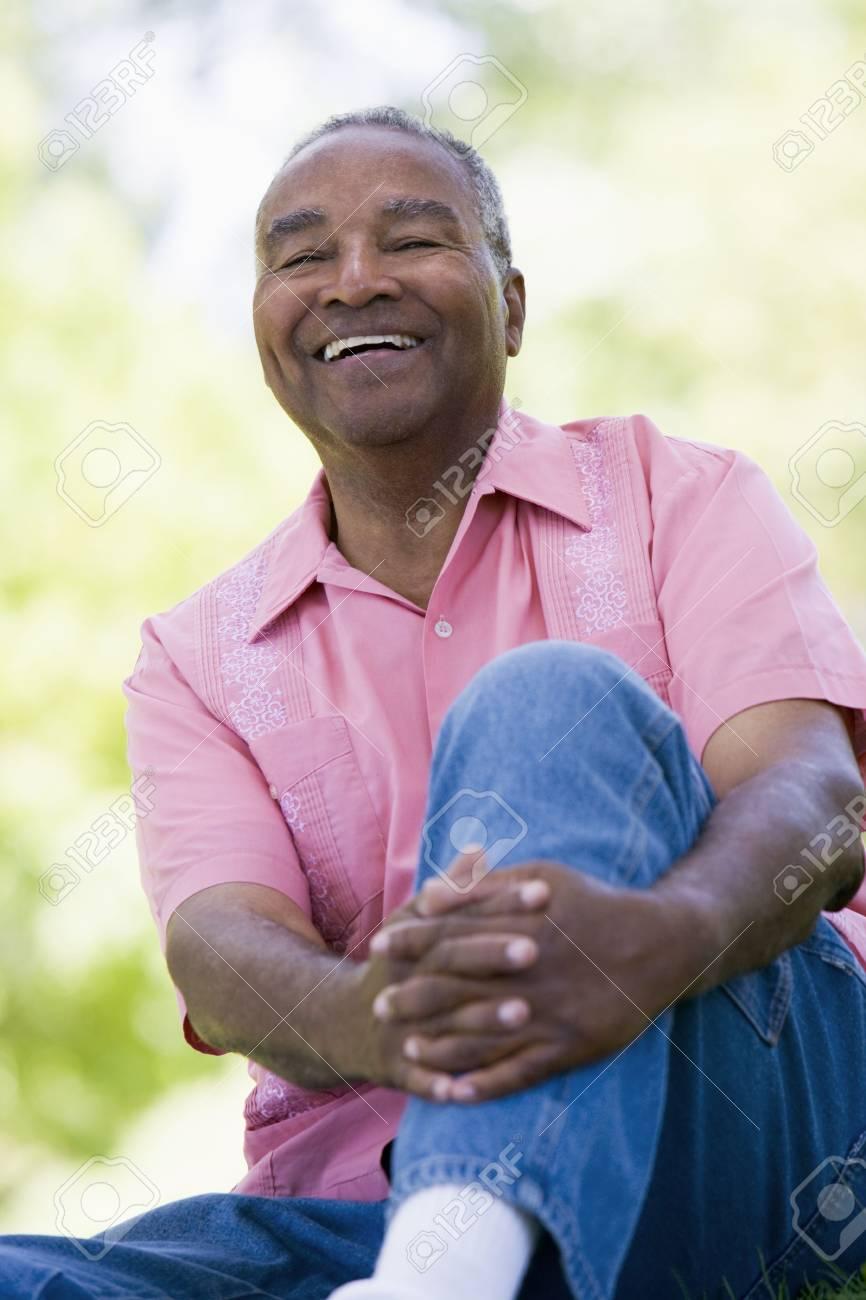 Senior man sitting outdoors Stock Photo - 3177001