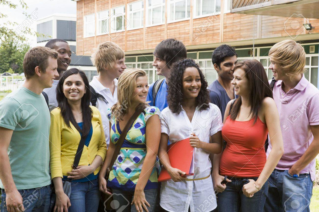 Group of students outdoors looking at camera smiling Stock Photo - 3201588