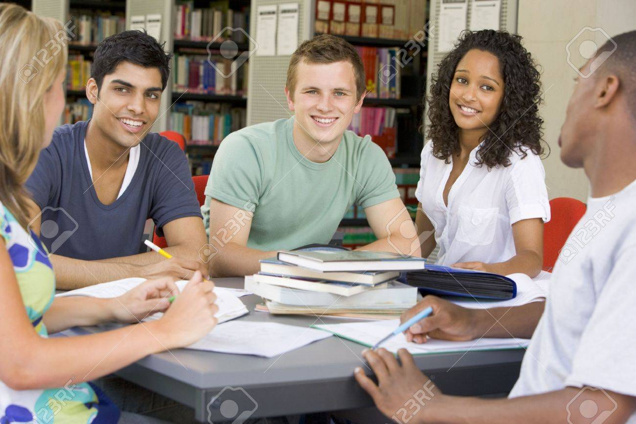 Five people in library studying (selective focus) Stock Photo - 3205266