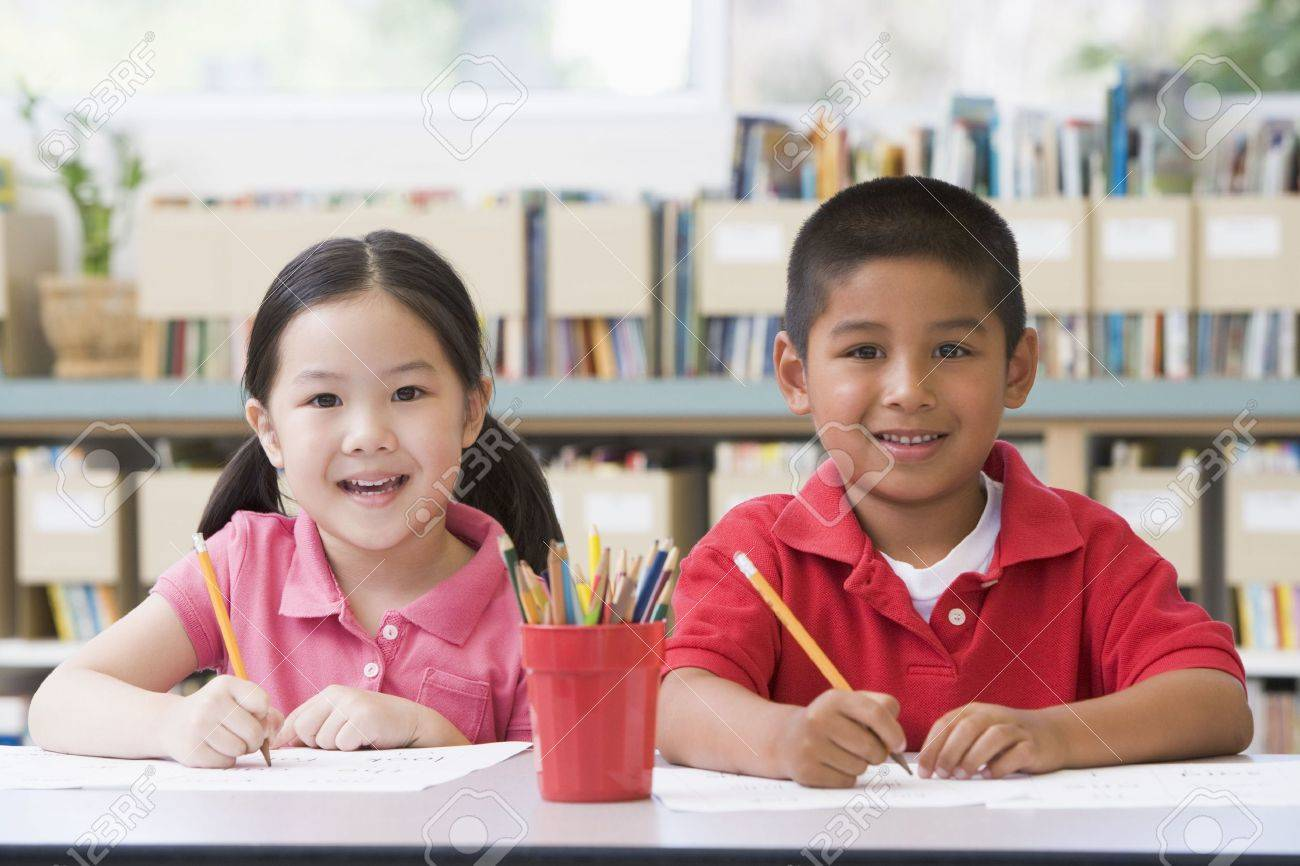 Two students in class writing Stock Photo - 3205123