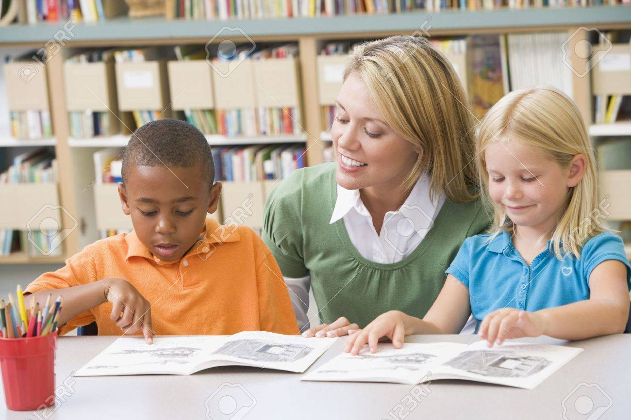 Worksheet Helping A Child Read two students in class reading with teacher stock photo picture teacher