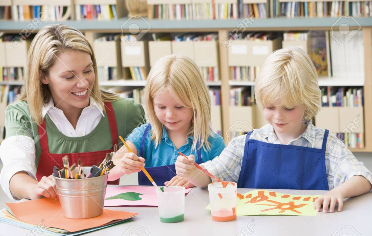 Two students in art class with teacher Stock Photo - 3207609