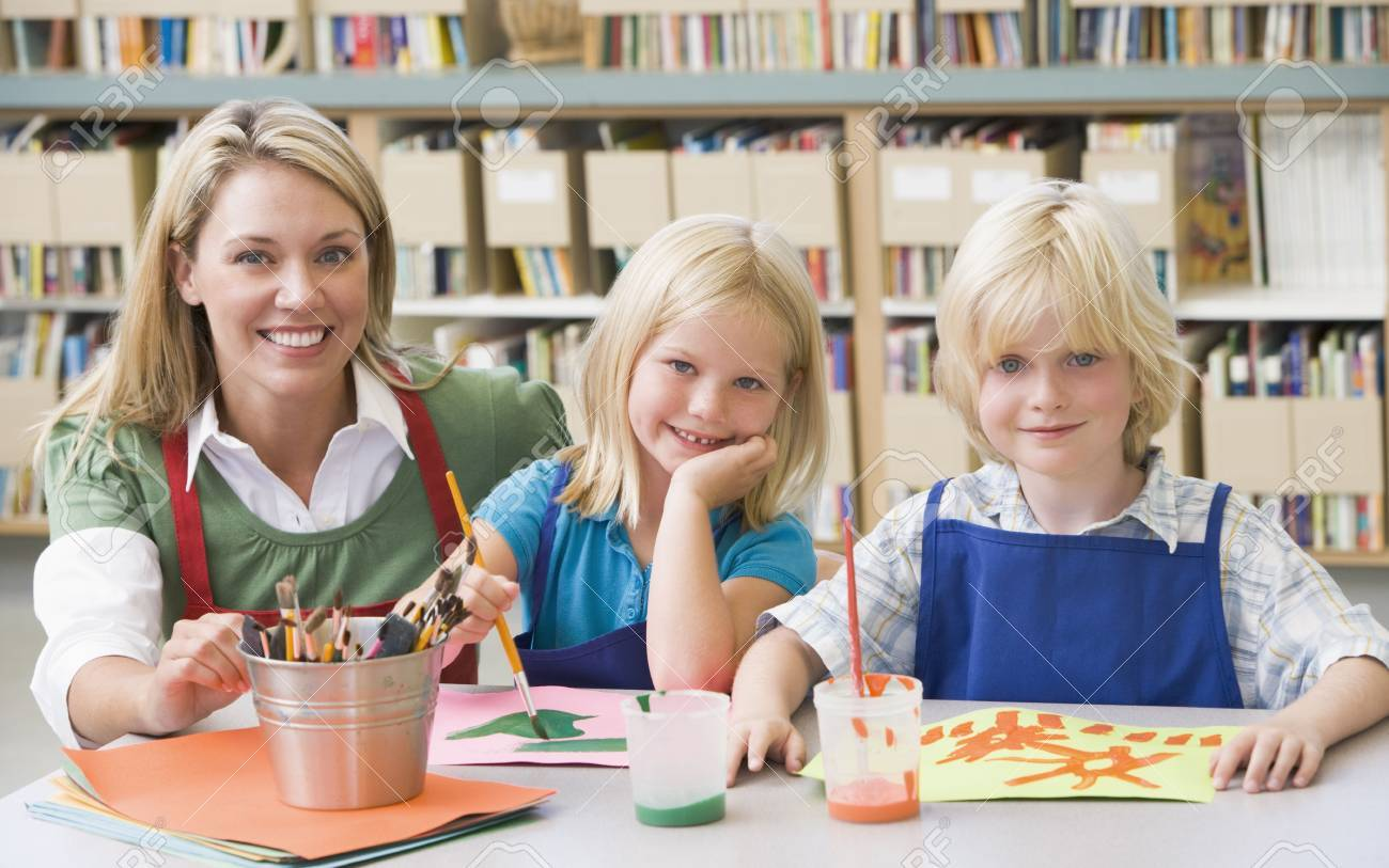 Two students in art class with teacher Stock Photo - 3207657