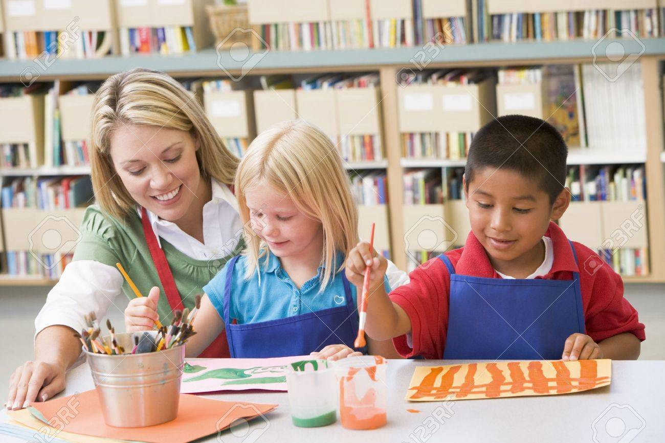 Two students in art class with teacher Stock Photo - 3207617