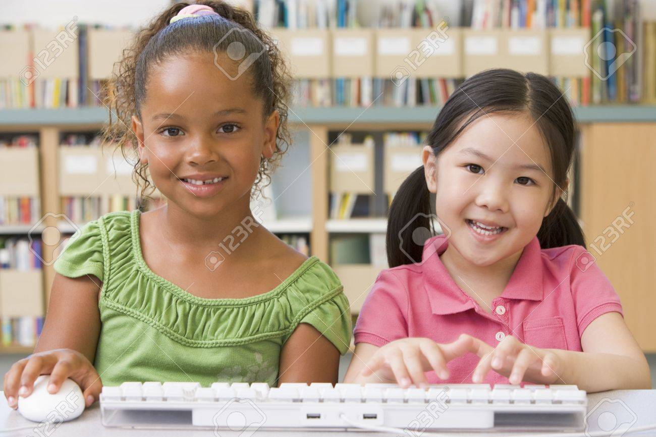 Two students in class at computer keyboard Stock Photo - 3207281