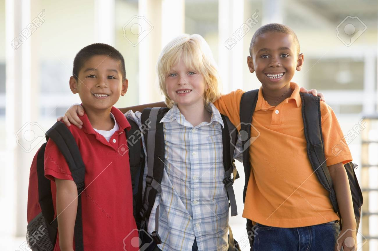 Three students outside school standing together smiling (selective focus) Stock Photo - 3207761