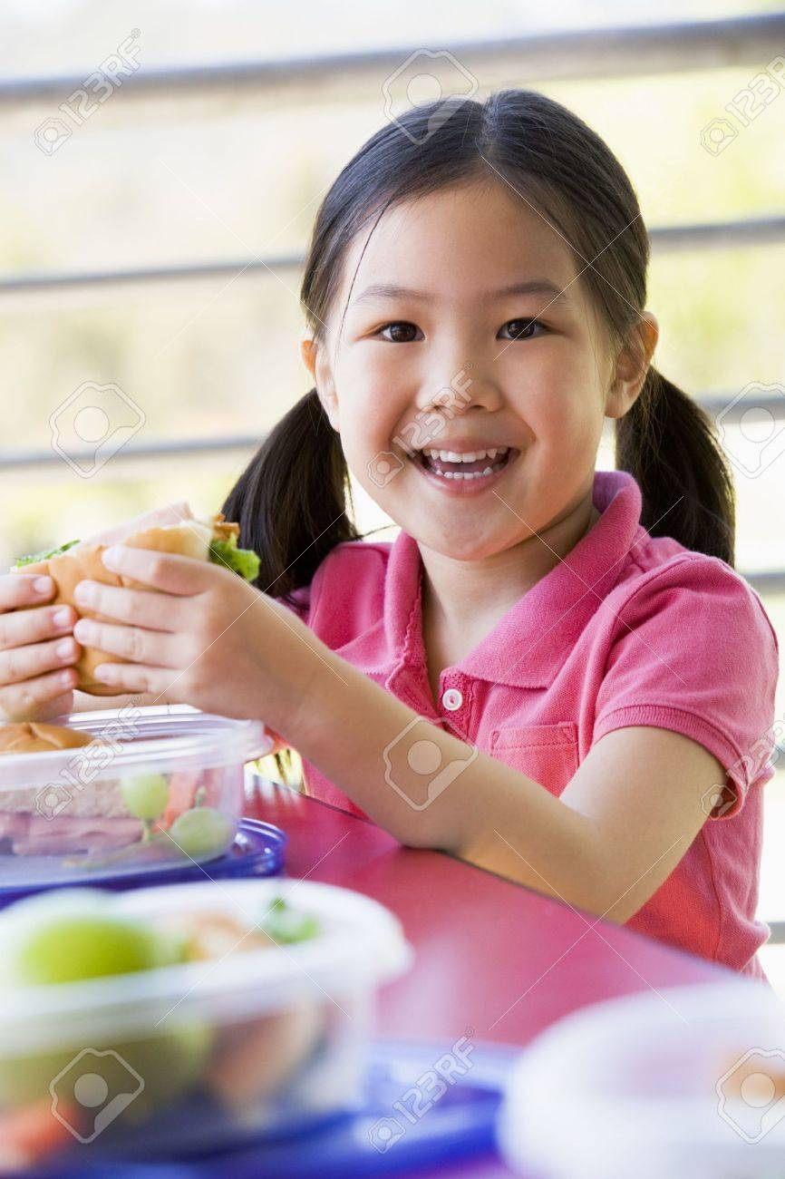 Student outdoors eating lunch (selective focus) Stock Photo - 3205122