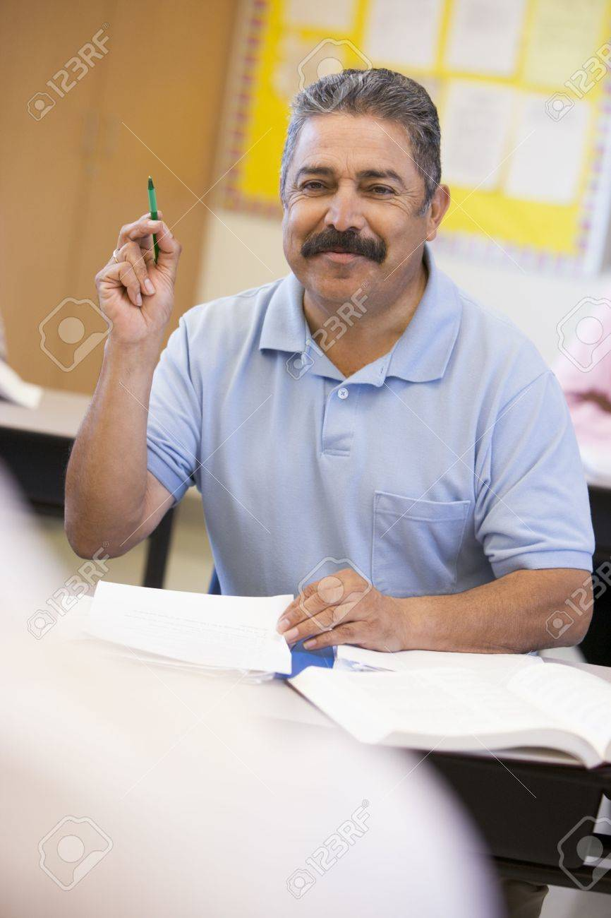 Adult student in class volunteering for teacher (selective focus) Stock Photo - 3194660