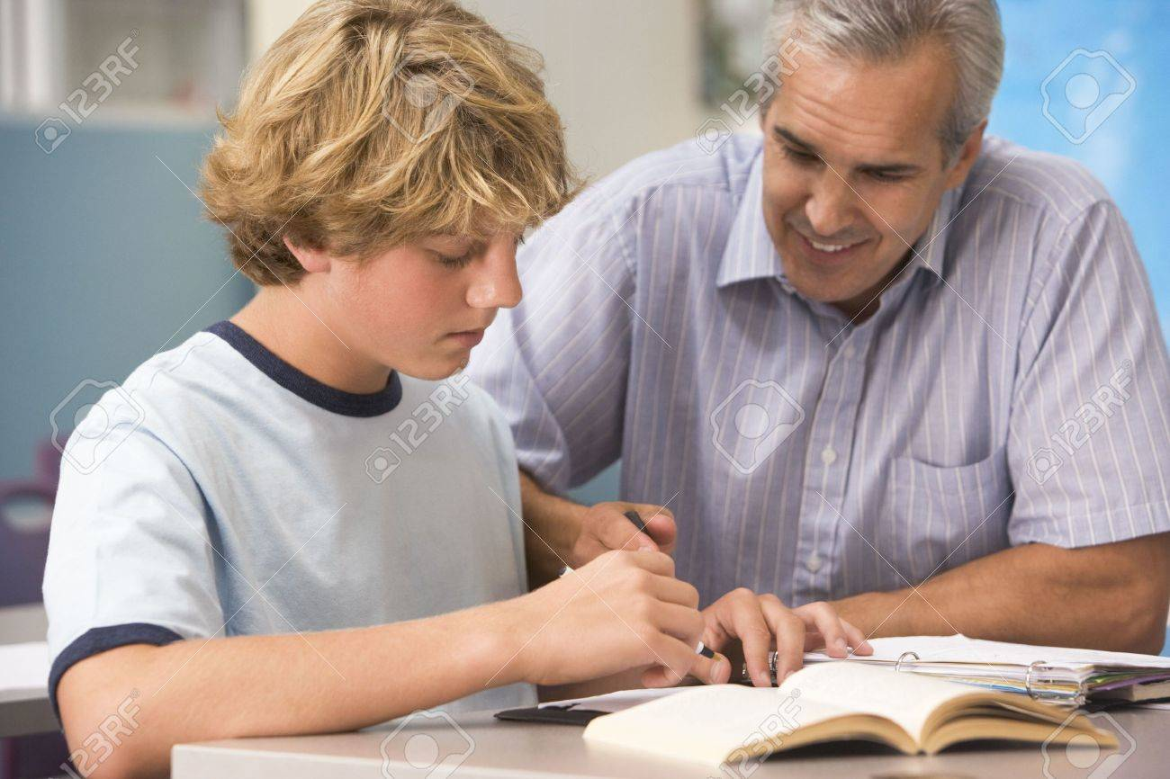 Teacher giving personal instruction to male student Stock Photo - 3207665