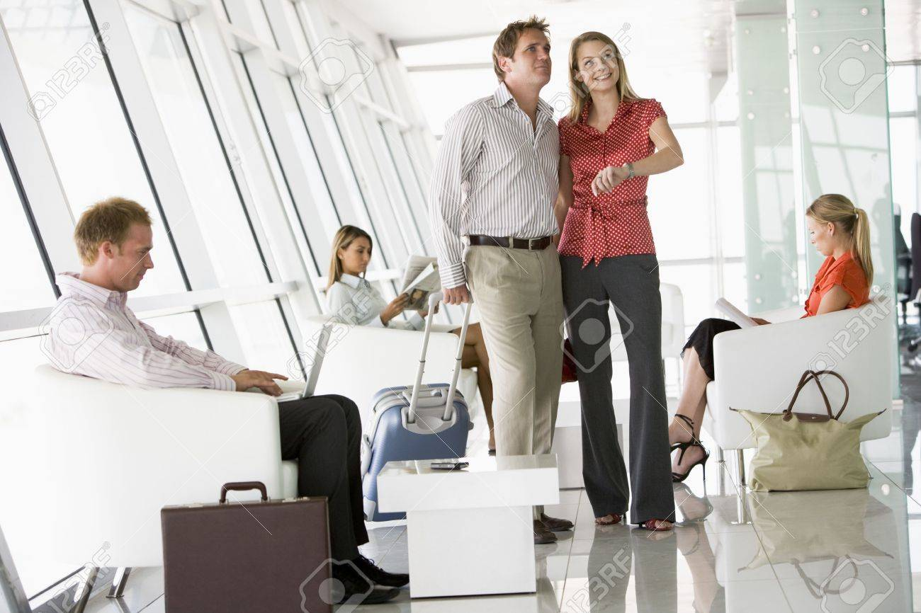 Couple waiting with other airline passengers in departure gate Stock Photo - 3177019