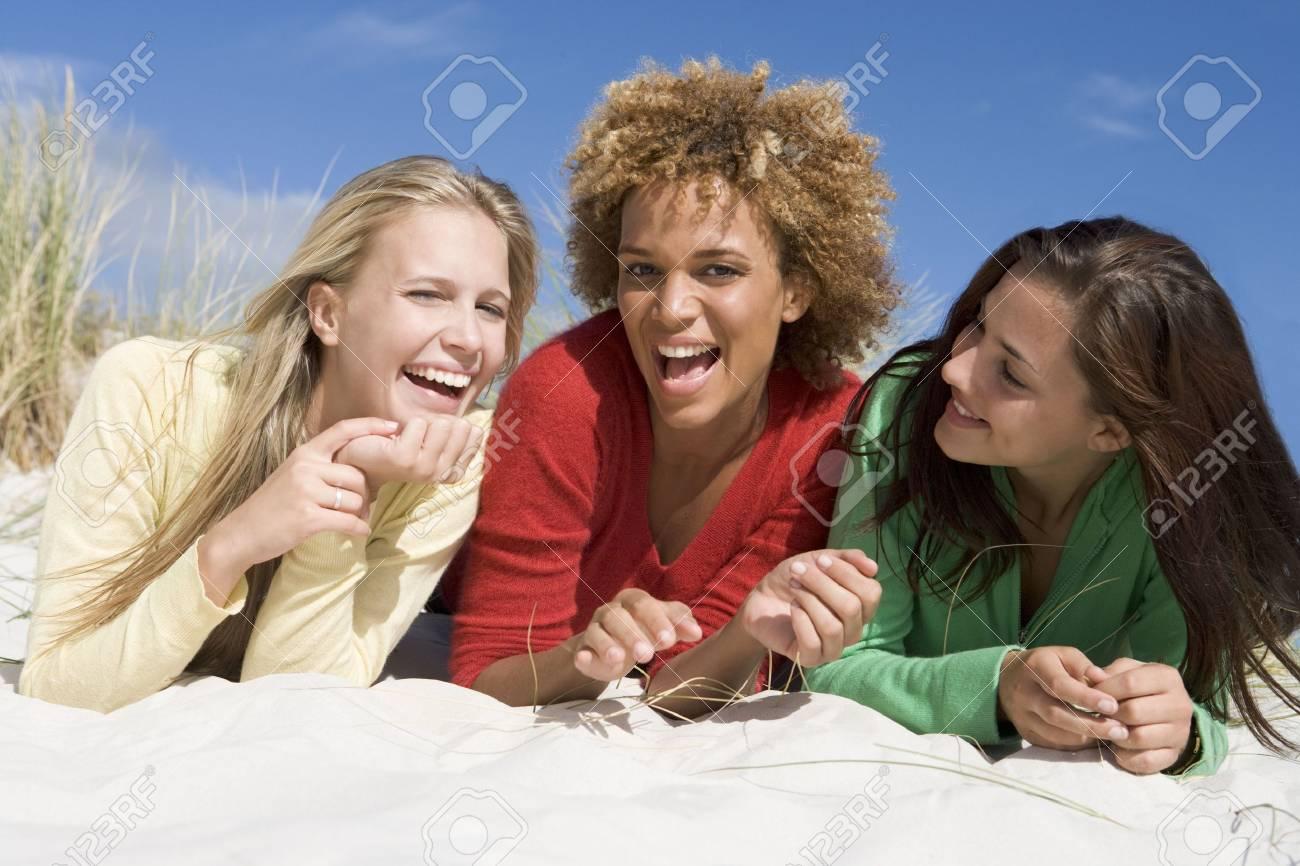 Three women posing on a sand hill Stock Photo - 3206796