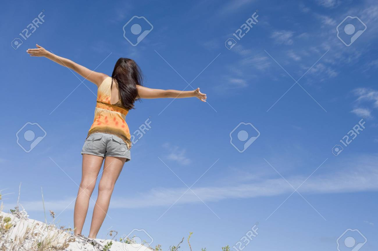 Young woman posing on a sand hill Stock Photo - 3204669