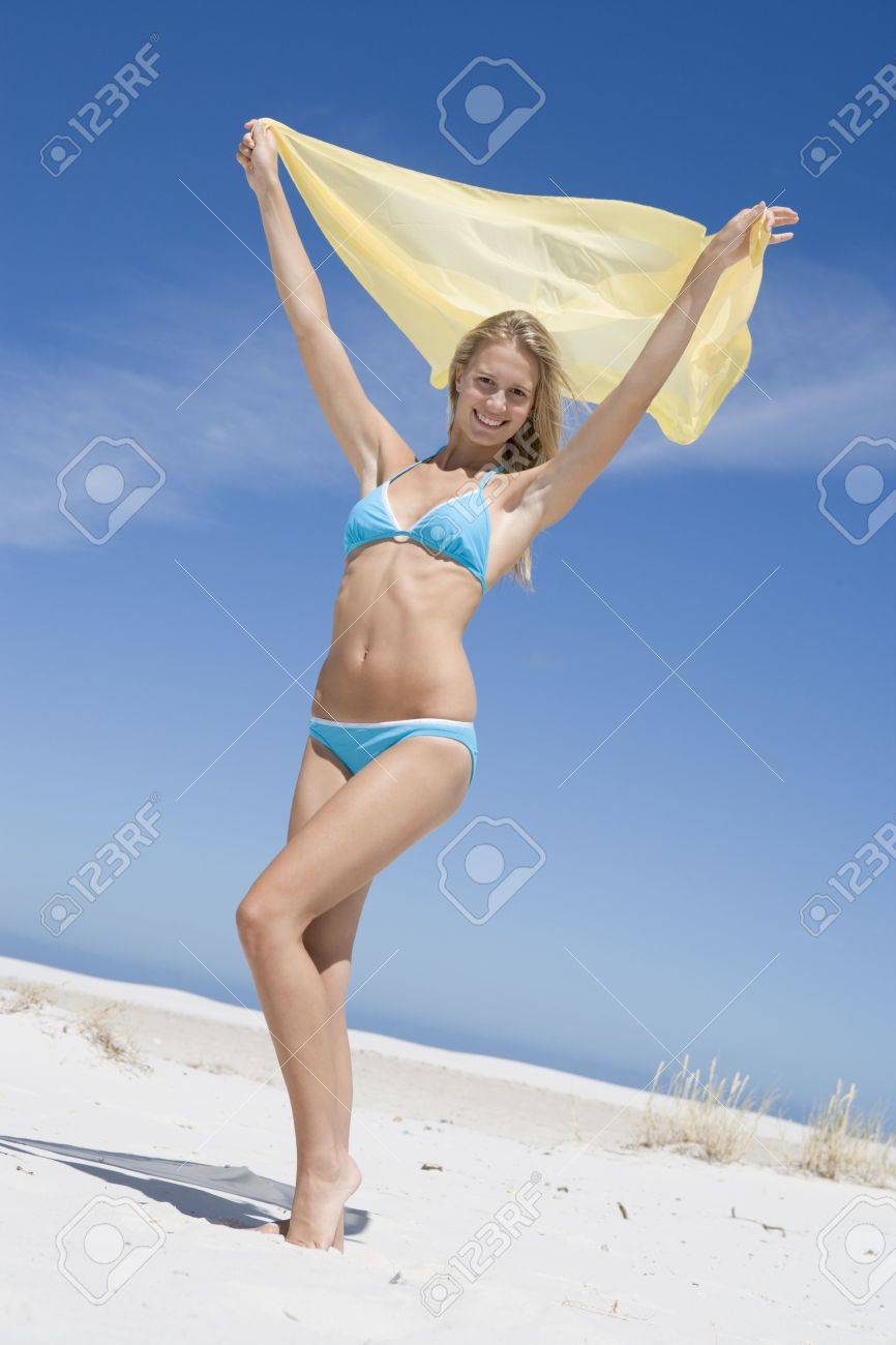 Young woman posing with a scarf on a beach Stock Photo - 3204637