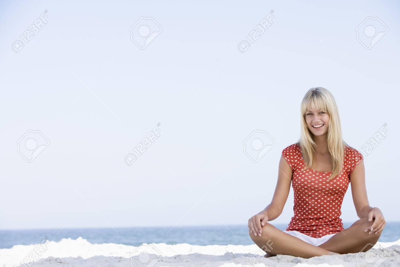 Young woman sitting on a beach Stock Photo - 3204627
