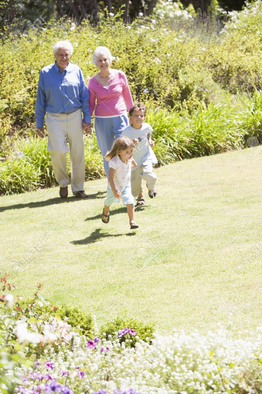 Grandparents walking with grandchildren. Stock Photo - 3460494