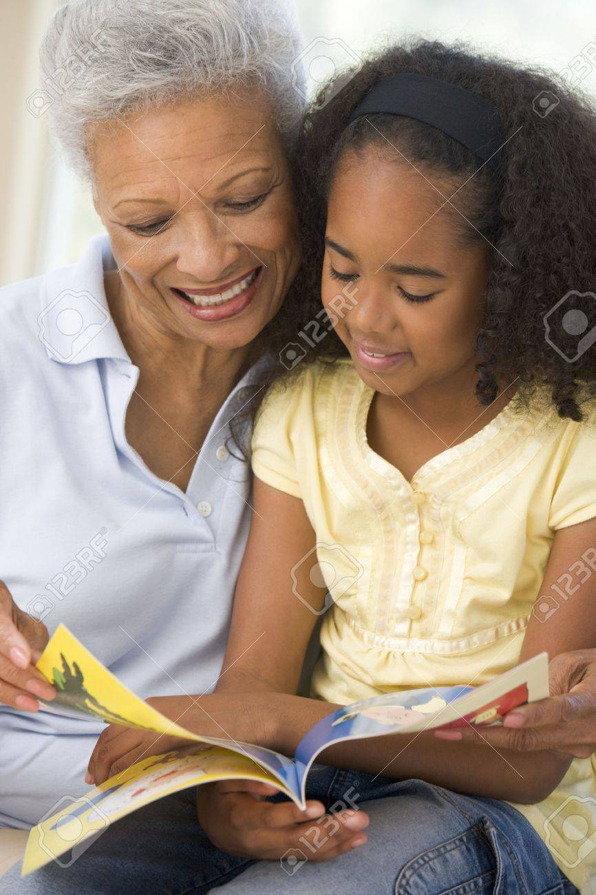 Grandmother and granddaughter reading and smiling Stock Photo - 3458986
