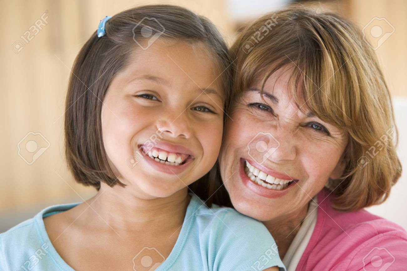 Grandmother and granddaughter smiling Stock Photo - 3460345