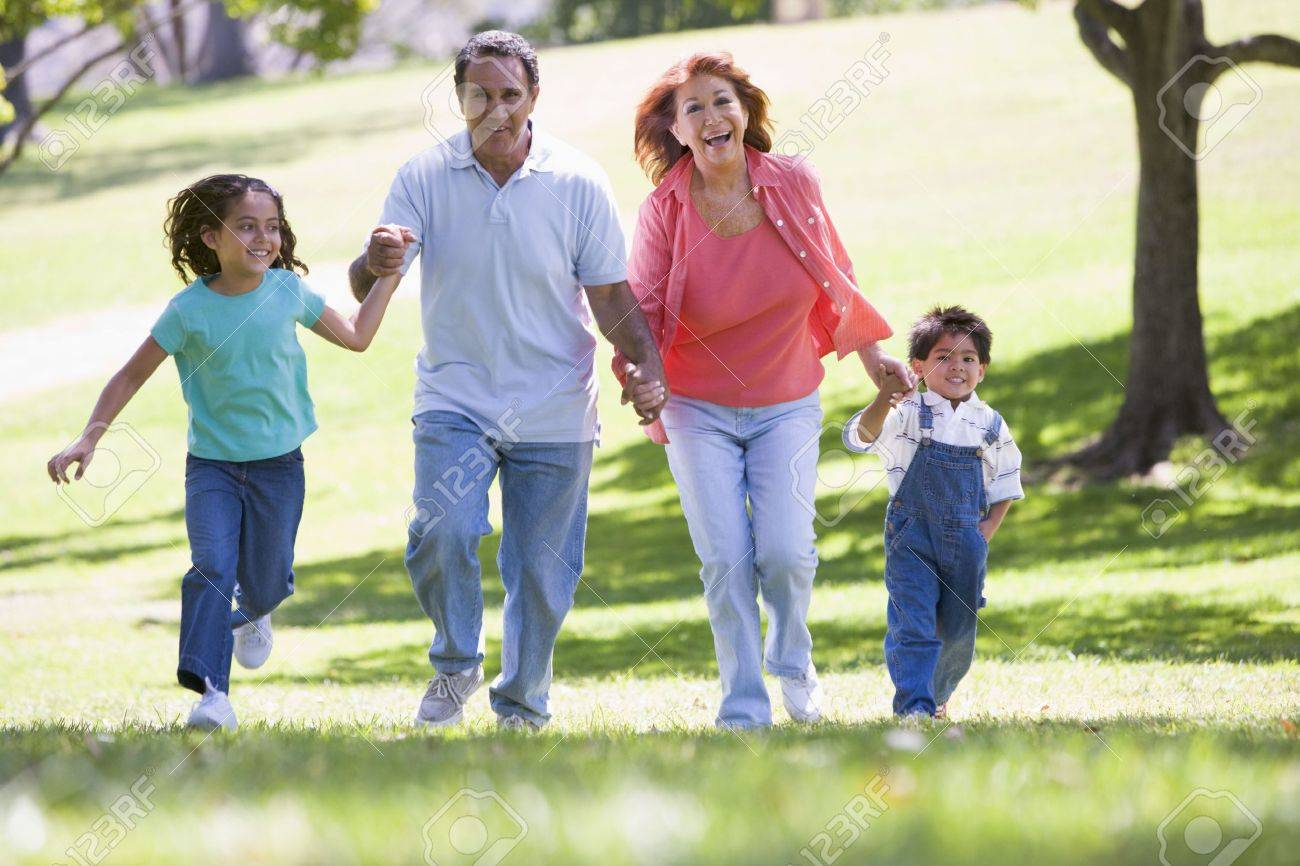Grandparents running with grandchildren. Stock Photo - 3460119