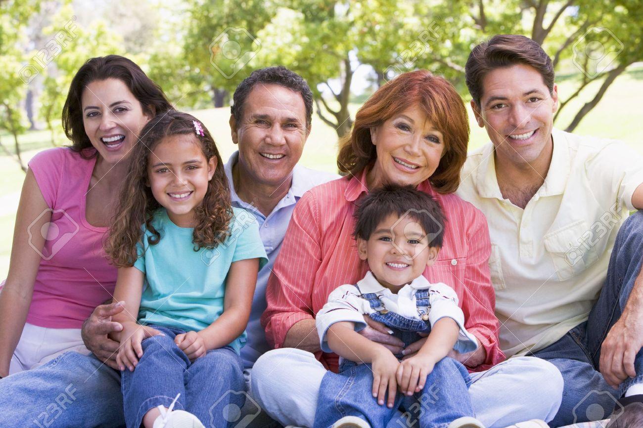 Extended family sitting outdoors smiling Standard-Bild - 3460478