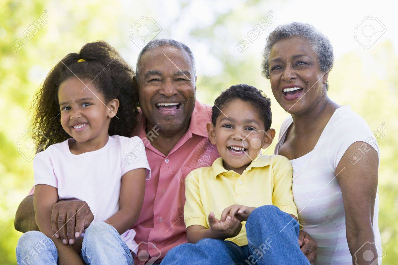 Grandparents laughing with grandchildren. Stock Photo - 3460177