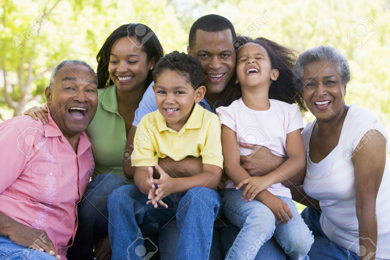 Extended family sitting outdoors smiling - 3460467