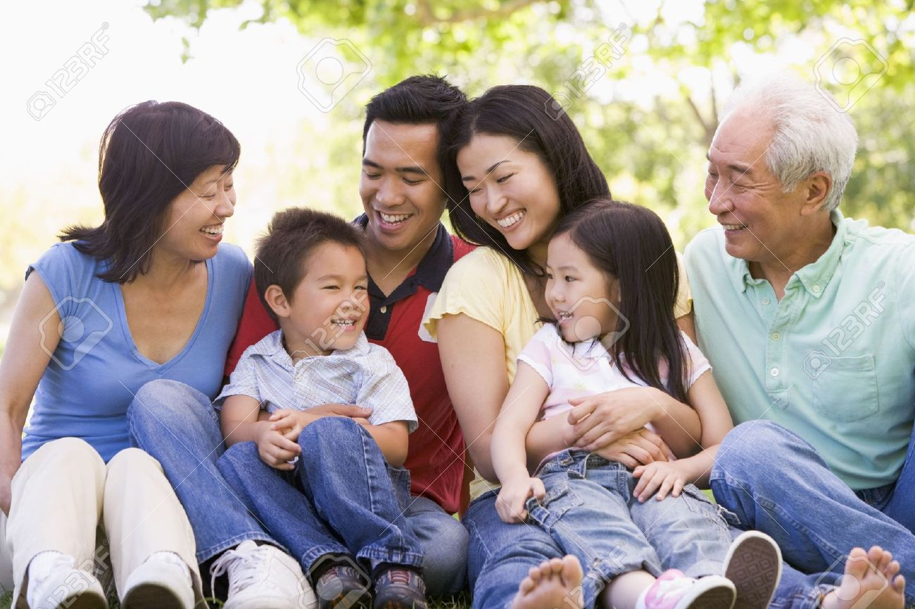 Extended family sitting outdoors smiling Stock Photo - 3460365