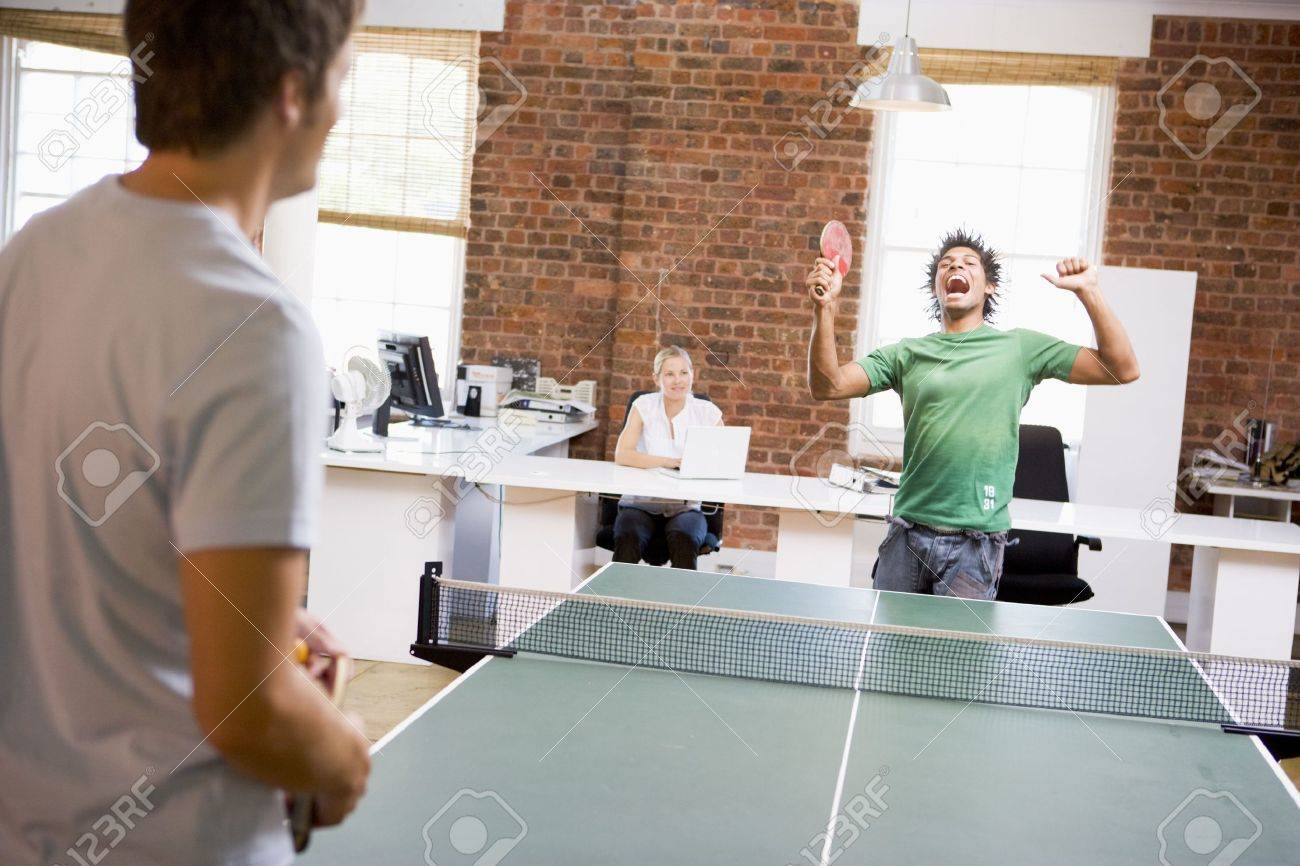 Two men in office space playing ping pong Stock Photo - 3472696