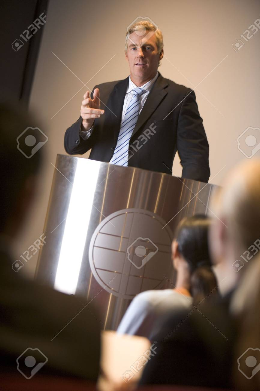 Businessman giving presentation at podium Stock Photo - 3472550