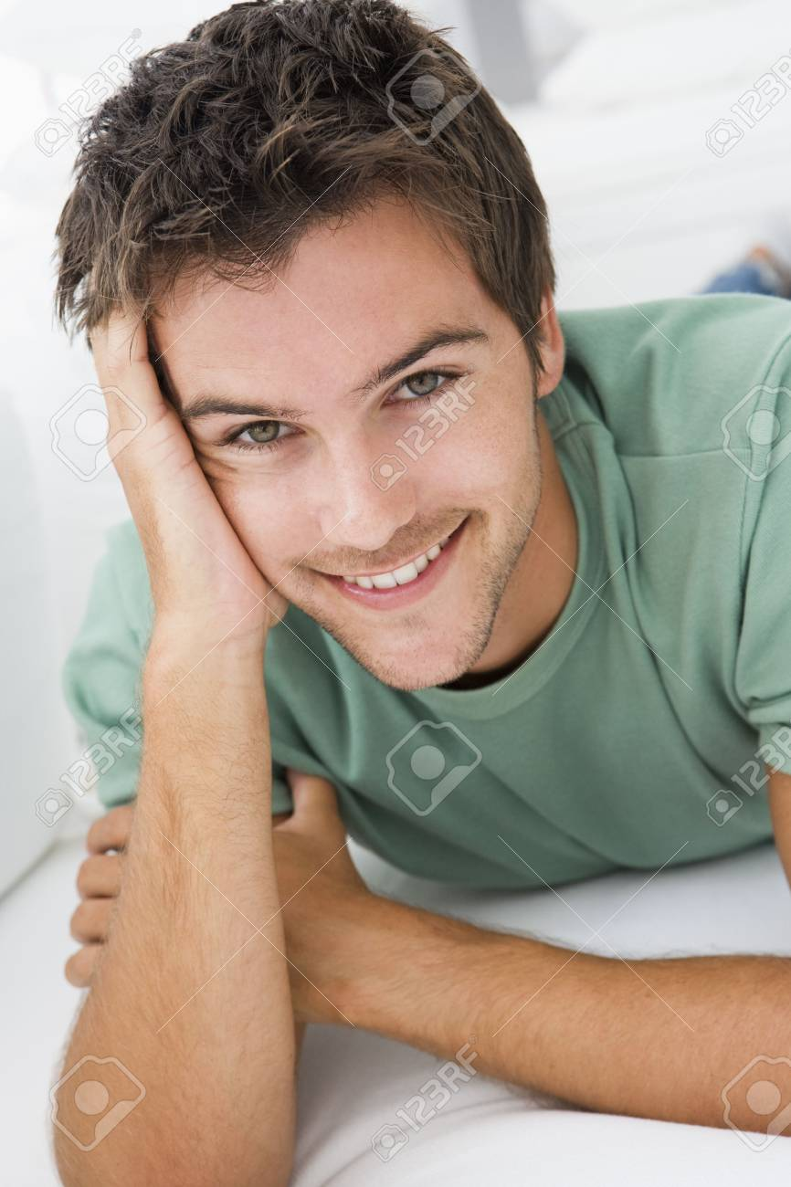 Man lying in living room smiling Stock Photo - 3472493