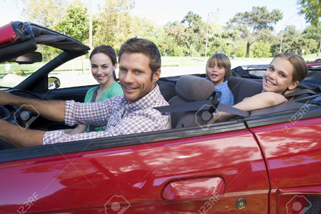 Family in convertible car smiling Stock Photo - 3475280