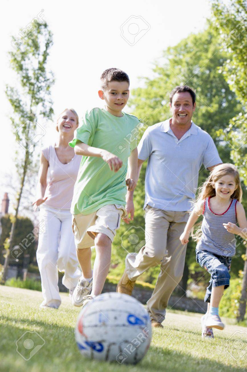Family outdoors playing soccer and having fun Stock Photo - 3461094