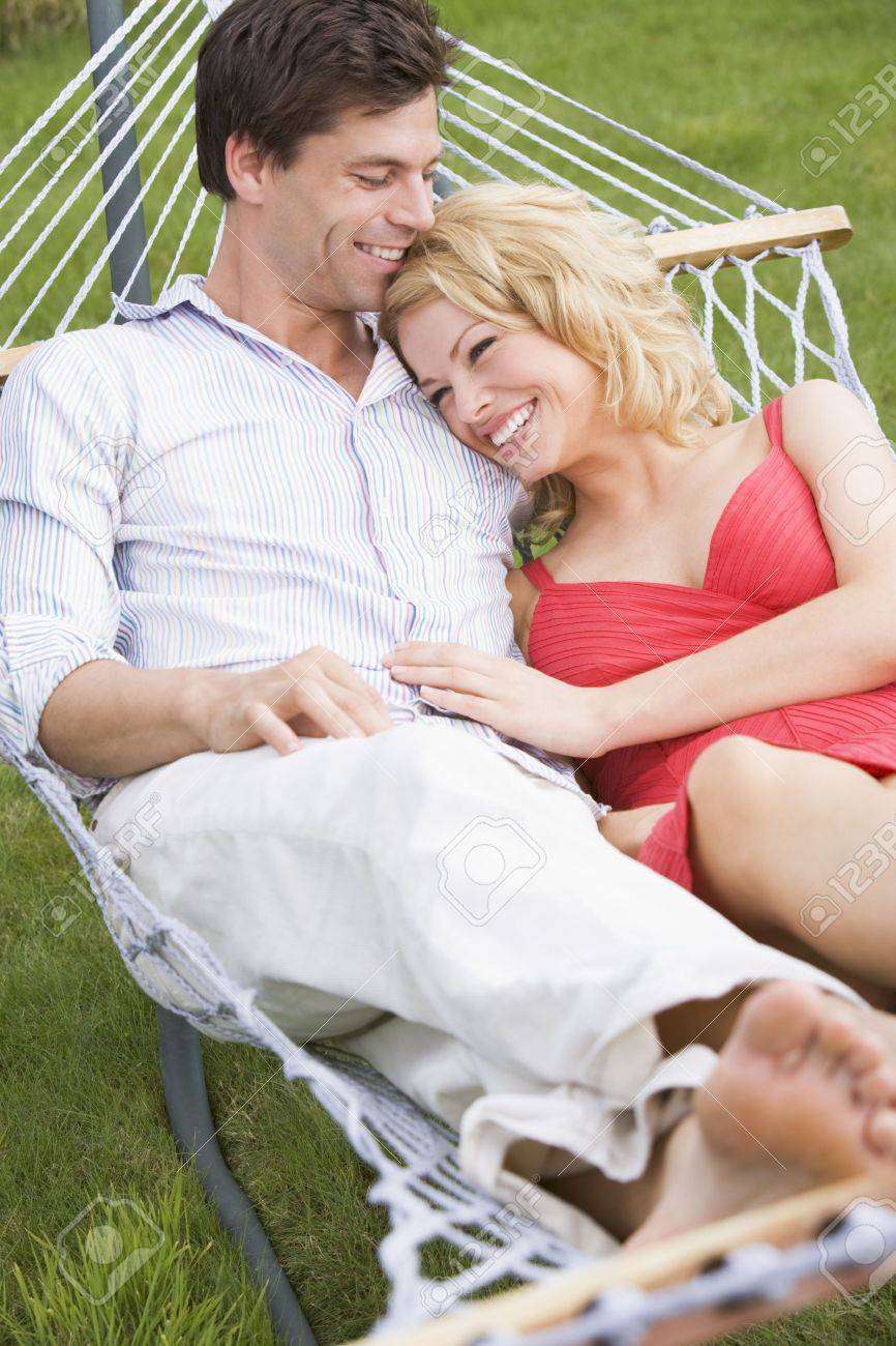 Couple relaxing in hammock smiling Stock Photo - 3475110