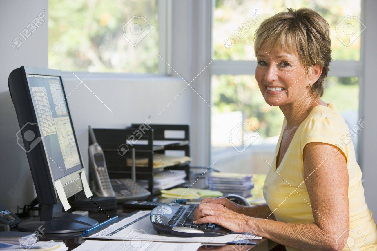 Strange Woman In Home Office Using Computer Smiling Stock Photo Picture Largest Home Design Picture Inspirations Pitcheantrous