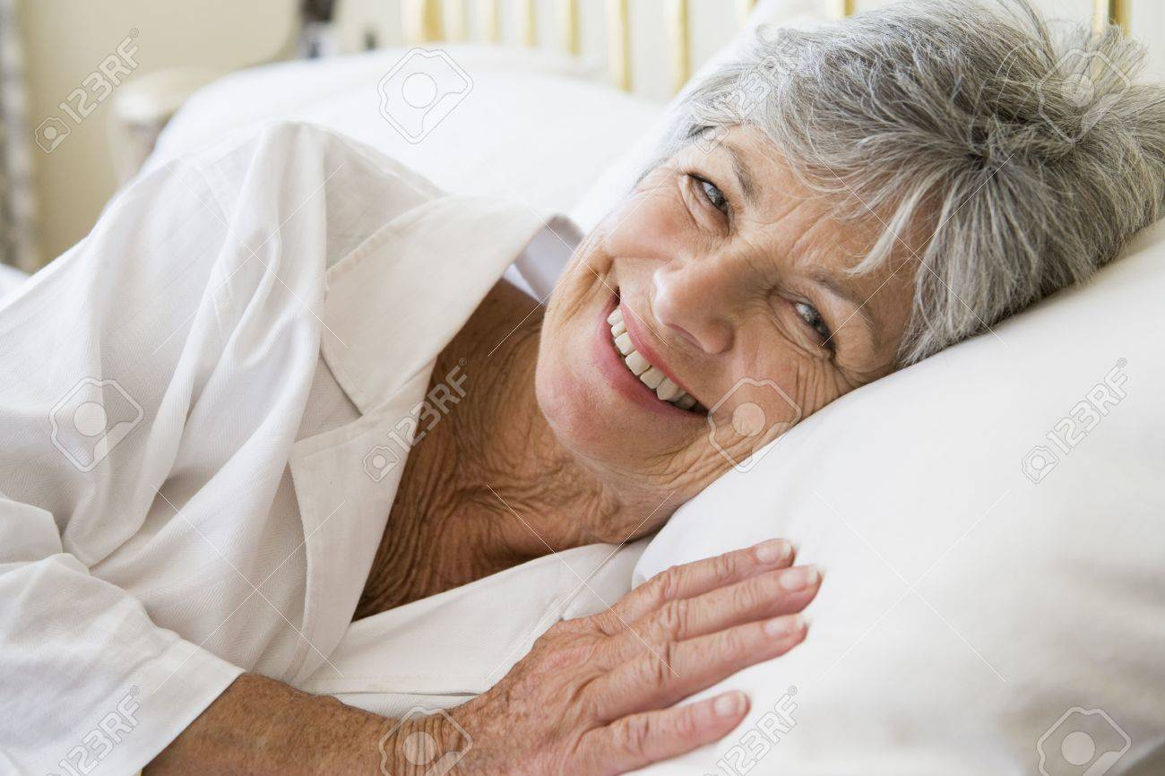 Woman lying in bed smiling Stock Photo - 3471565