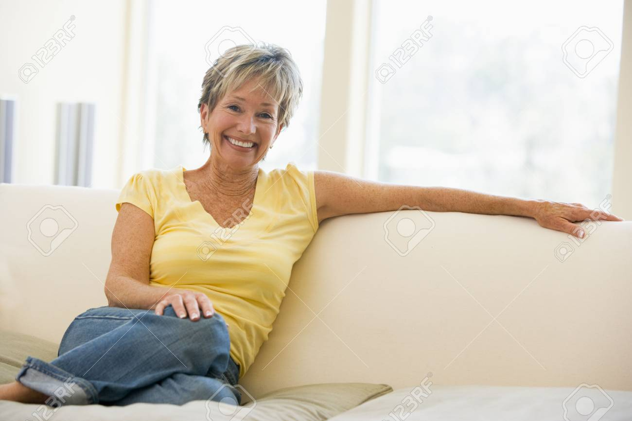 Woman in living room smiling Stock Photo - 3475582