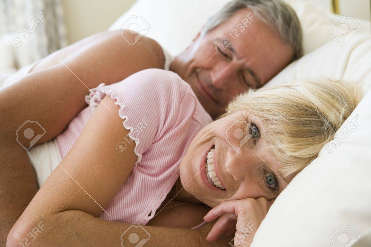 Couple lying in bed together smiling Stock Photo - 3475857