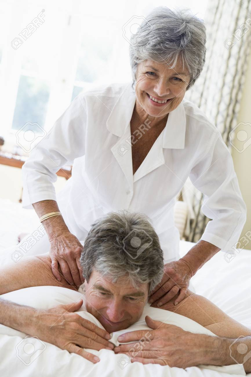 Man receiving a massage from a woman Stock Photo - 3475758