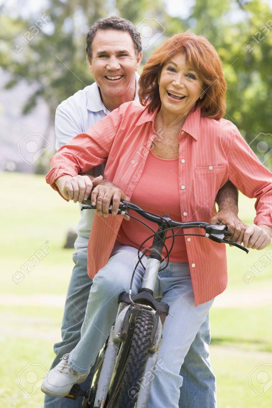 Mature couple bike riding. Stock Photo - 3475901