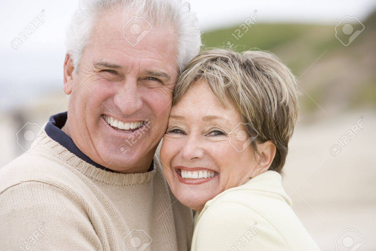 Couple at the beach smiling Stock Photo - 3475815