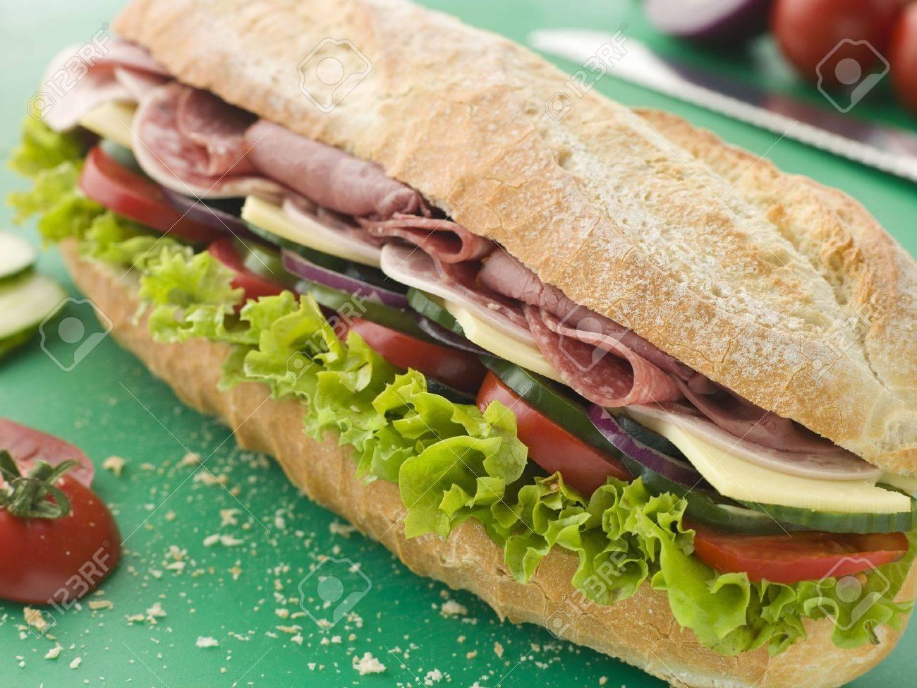 Deli Sub Sandwich on a Chopping Board Stock Photo - 3443931
