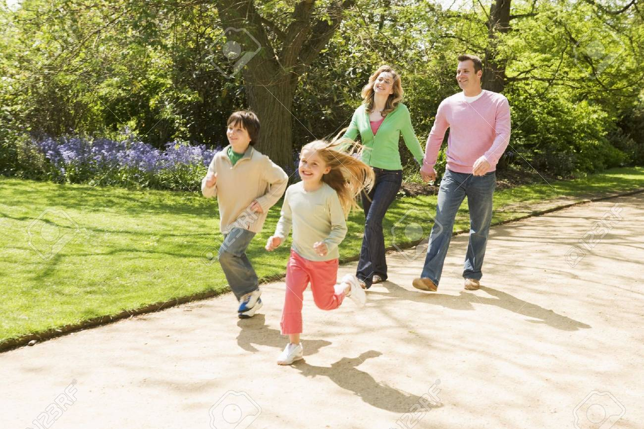 Family running on path holding hands smiling Stock Photo - 3476332