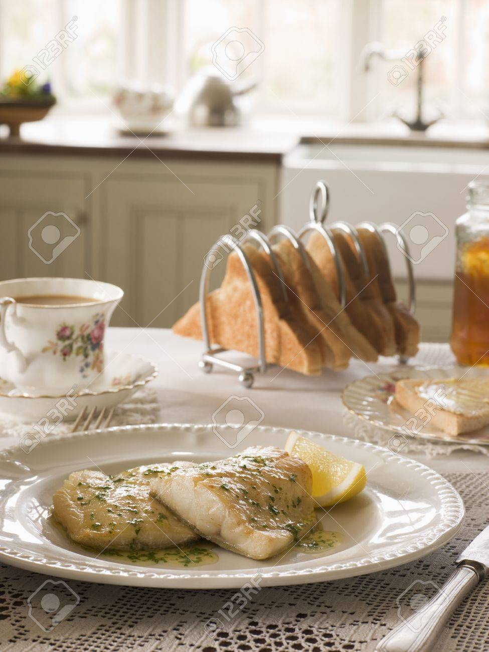 Smoked Haddock with Herb Butter and Toast Stock Photo - 3449561
