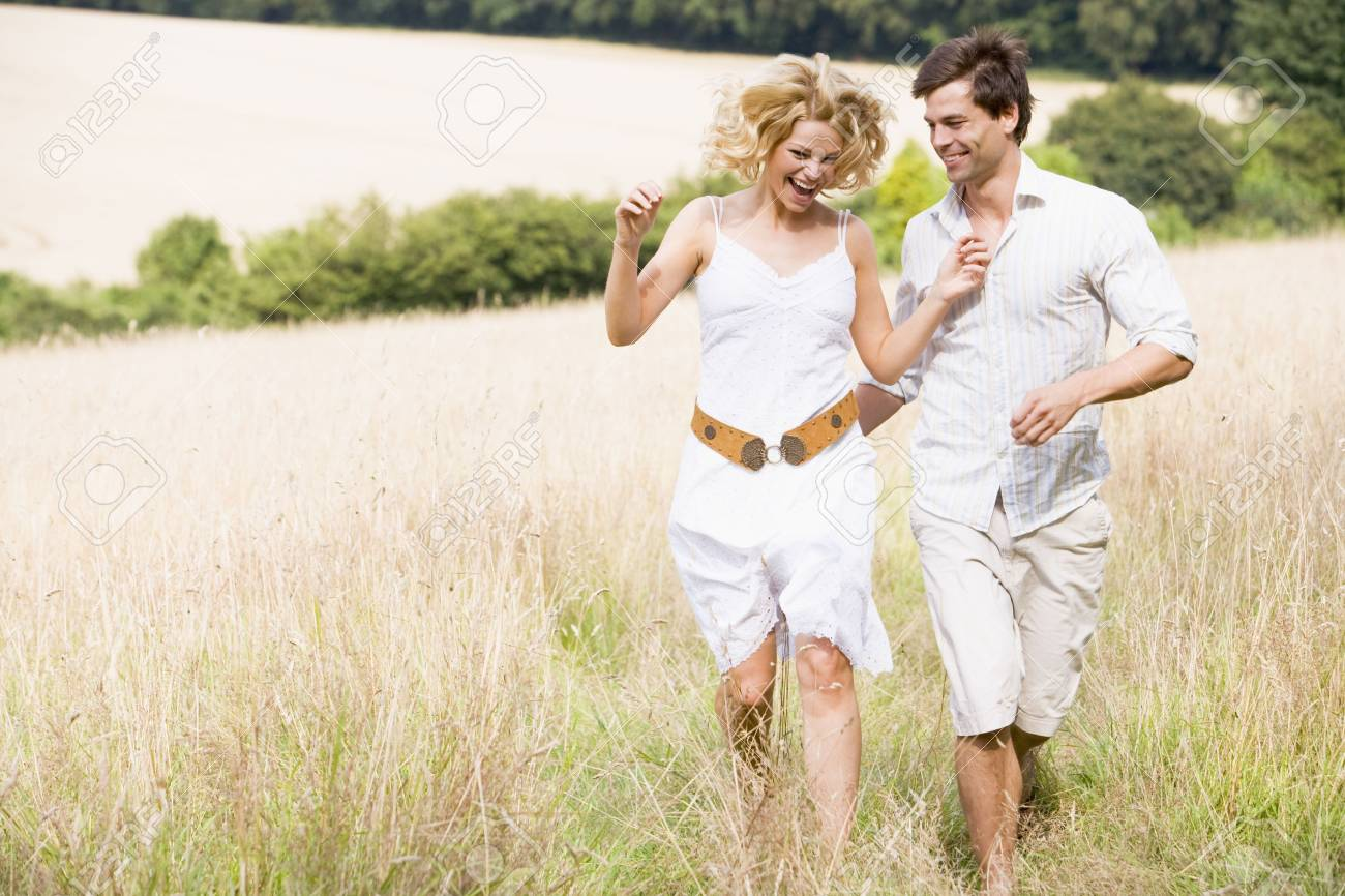 Couple running outdoors smiling Stock Photo - 3600401