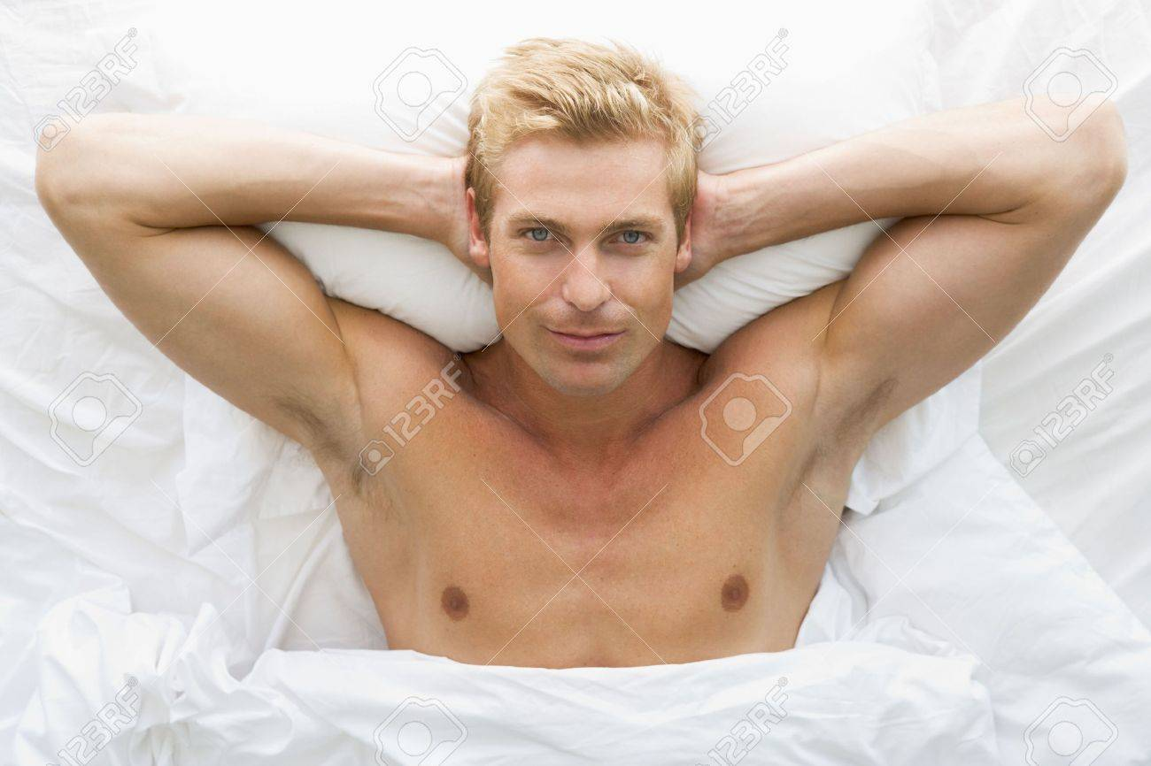 Man lying in bed relaxing Stock Photo - 3476380