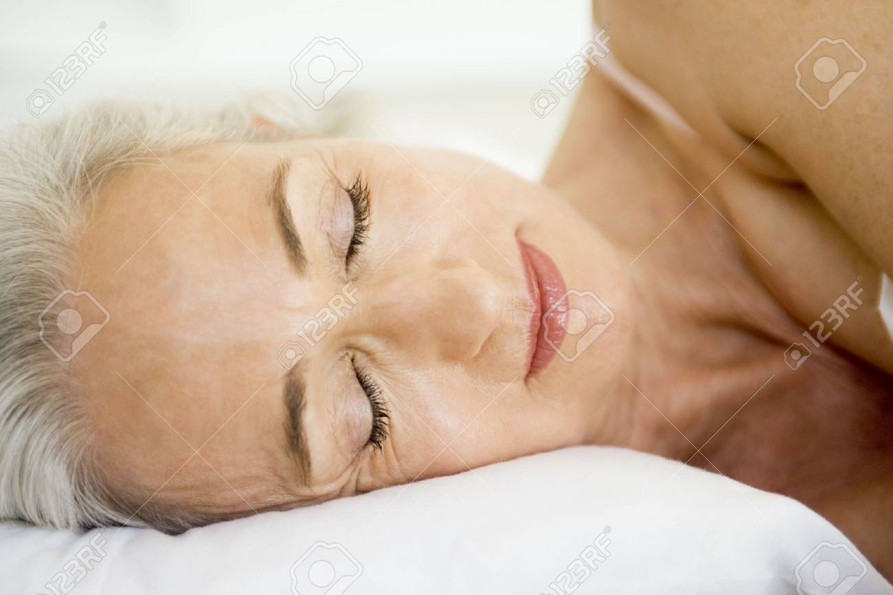 Woman lying in bed sleeping Stock Photo - 3477441