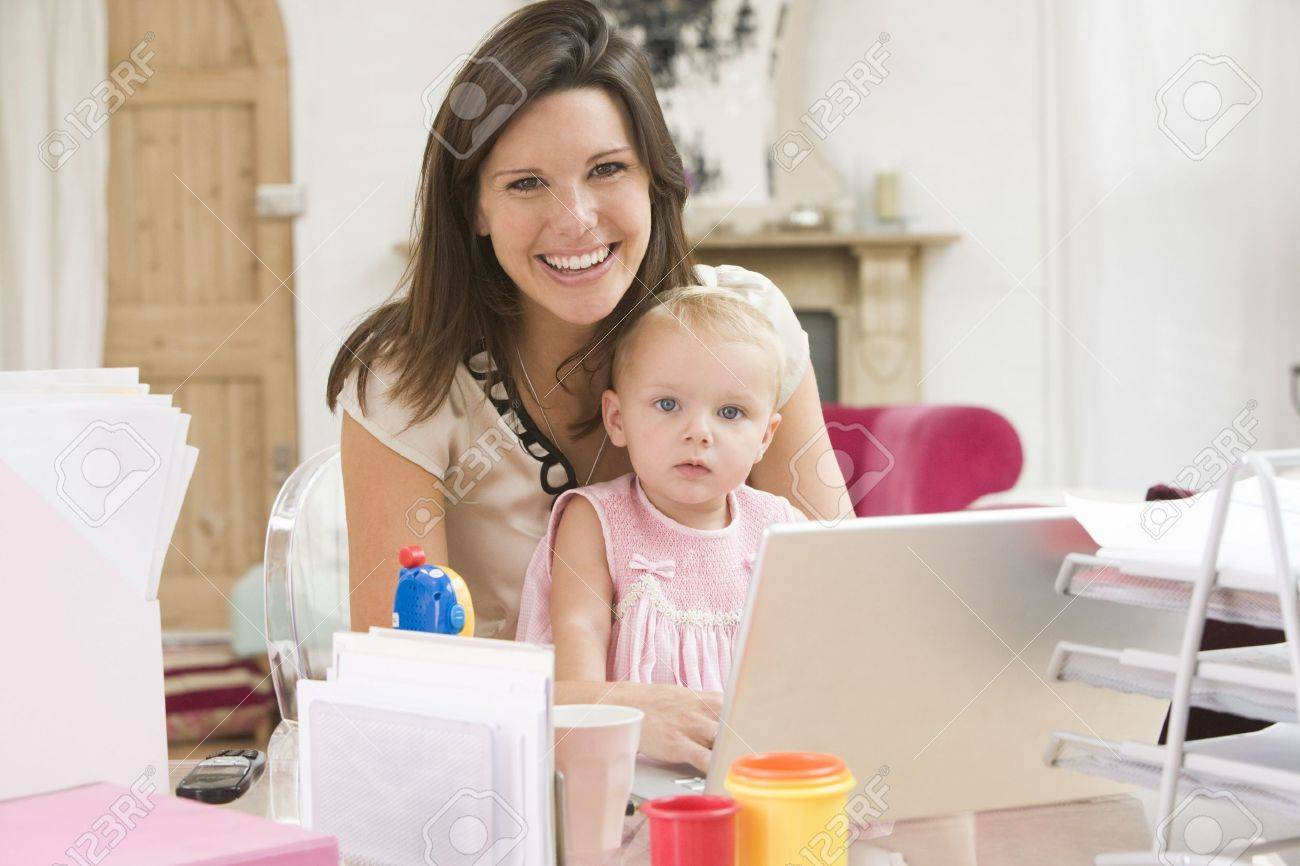 Mother and baby in home office with laptop Stock Photo - 3600846