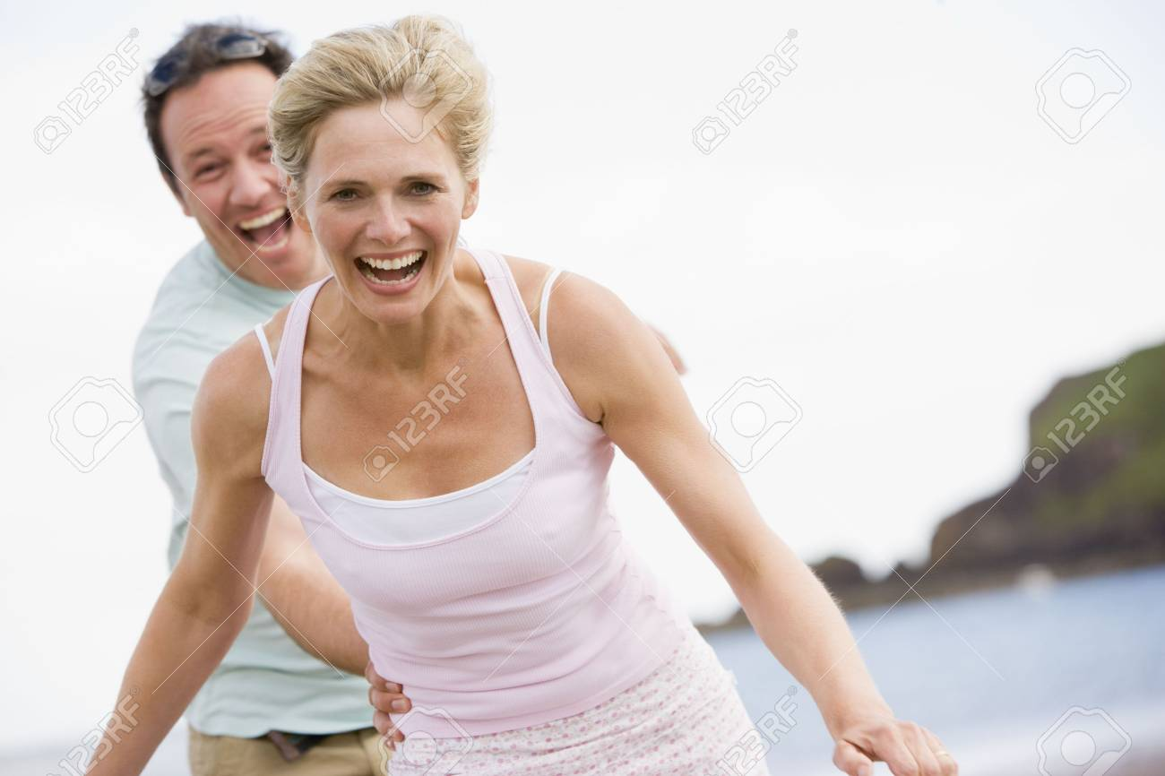 Couple at the beach smiling Stock Photo - 3600589