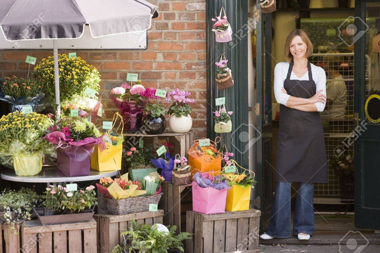 Woman working at flower shop smiling Stock Photo - 3726363