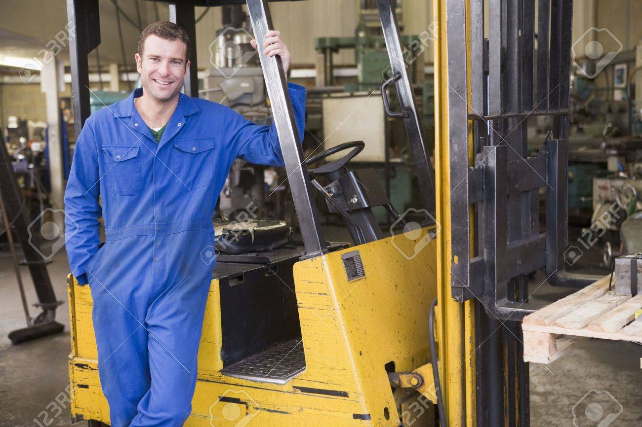 Warehouse worker standing by forklift stock photo picture and warehouse worker standing by forklift stock photo 3603332 sciox Choice Image